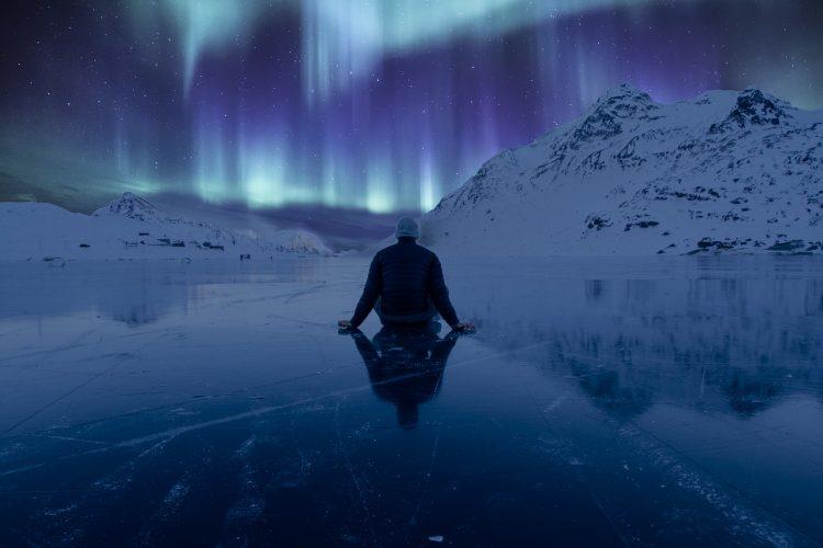 Man watching artic lights